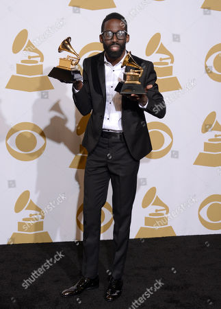 """Tye Tribbett poses in the press room with the awards for best gospel album for """"Greater Than"""" and best gospel song for """"If He Did It Before... Same God"""" at the 56th annual GRAMMY Awards at Staples Center, in Los Angeles"""
