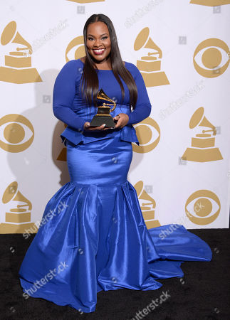 """Tasha Cobbs poses in the press room with the award for best gospel/contemporary Christian music performance for """"Break Every Chain"""" at the 56th annual GRAMMY Awards at Staples Center, in Los Angeles"""
