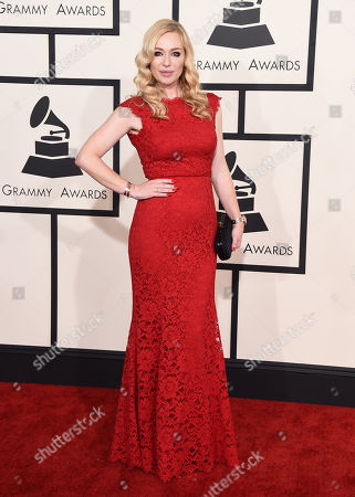 Isabel Adrian arrives at the 57th annual Grammy Awards at the Staples Center, in Los Angeles