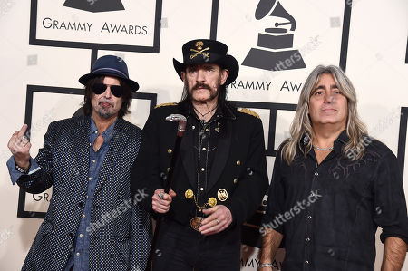 Phil Campbell, from left, Lemmy Kilmister, and Mikkey Dee of Motorhead arrive at the 57th annual Grammy Awards at the Staples Center, in Los Angeles