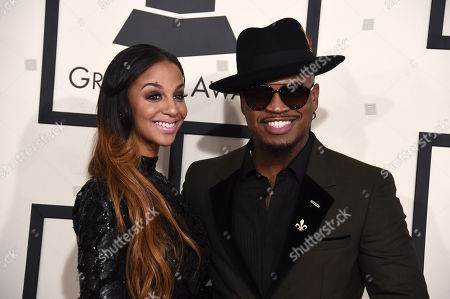 Ne-Yo, right, and Monyetta Shaw arrive at the 57th annual Grammy Awards at the Staples Center, in Los Angeles