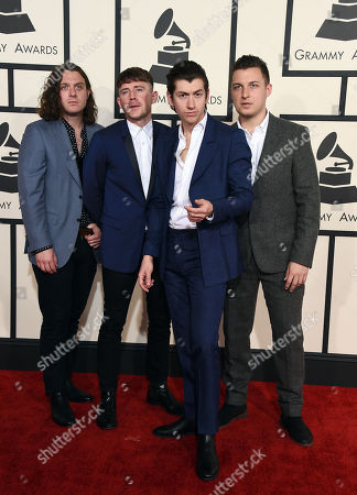 Nick O'Malley, from left, Jamie Cook, Alex Turner and Matt Helders of Arctic Monkeys arrive at the 57th annual Grammy Awards at the Staples Center, in Los Angeles