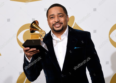 Smokie Norful poses in the press room with the award for best gospel performance/song for â?œNo Greater Loveâ?? at the 57th annual Grammy Awards at the Staples Center, in Los Angeles