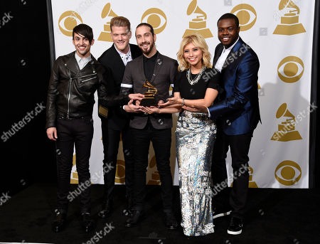 "Mitch Grassi, from left, Scott Hoying, Avi Kaplan, Kirstie Maldonado and Kevin Olusola, of Pentatonix, pose in the press room with the award for best arrangement, instrumental or a cappella for ""Daft Punk"" at the 57th annual Grammy Awards at the Staples Center, in Los Angeles"