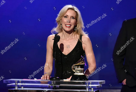 Kimberly Woolen accepts the award for best country song for I'm Not Gonna Miss You on behalf of Glen Campbell at the 57th annual Grammy Awards, in Los Angeles