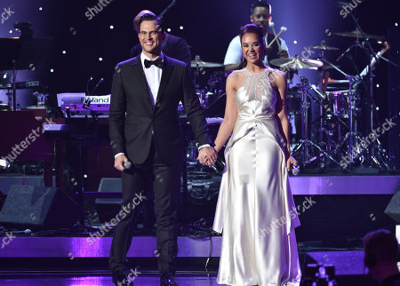 Stock Picture of Cheyenne Jackson, left, and Alexandra Silber perform at the 57th annual Grammy Awards, in Los Angeles