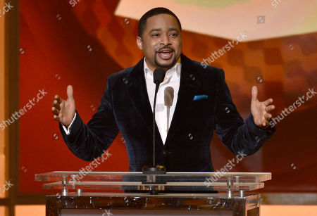 Smokie Norful speaks on stage at the 57th annual Grammy Awards, in Los Angeles