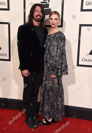 Dave Grohl, left, and Jordyn Blum arrive at the 58th annual Grammy Awards at the Staples Center, in Los Angeles