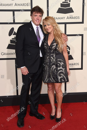 Frank Liddell, left, and Lee Ann Womack arrive at the 58th annual Grammy Awards at the Staples Center, in Los Angeles
