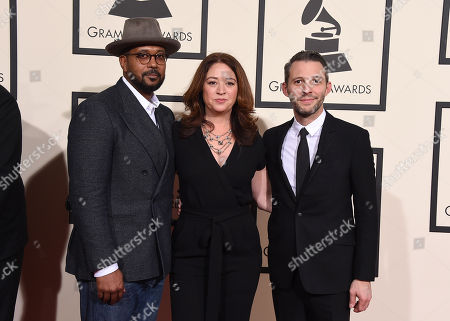 Jayson Jackson, from left, Liz Garbus, and Justin Wilkes arrive at the 58th annual Grammy Awards at the Staples Center, in Los Angeles