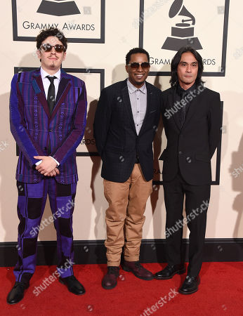 Russell Elevado, from left, Chris Dave, and Ben Kane arrive at the 58th annual Grammy Awards at the Staples Center, in Los Angeles