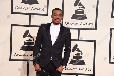 Jonathan McReynolds arrives at the 58th annual Grammy Awards at the Staples Center, in Los Angeles
