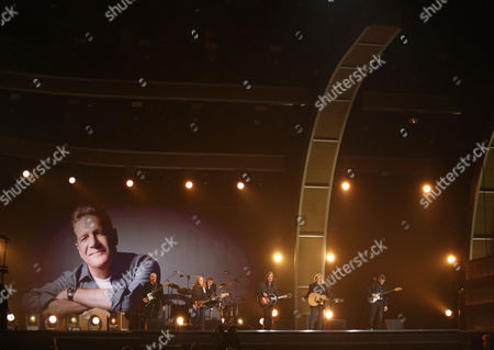 "Stock Photo of Bernie Leadon, from left, Don Henley, Timothy B. Schmit, Jackson Browne, Joe Walsh, and Steuart Smith perform ""Take It Easy"" during a tribute to Glenn Frey at the 58th annual Grammy Awards, in Los Angeles"