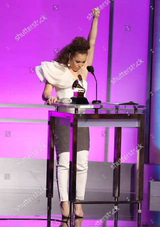 """Kendra Foster accepts the award for best R&B song for Really Love"""" at the 58th annual Grammy Awards, in Los Angeles"""