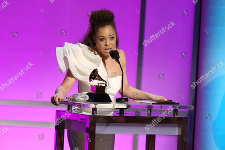 """Kendra Foster accepts the award for best R&B song for â?oeReally Love"""" at the 58th annual Grammy Awards, in Los Angeles"""