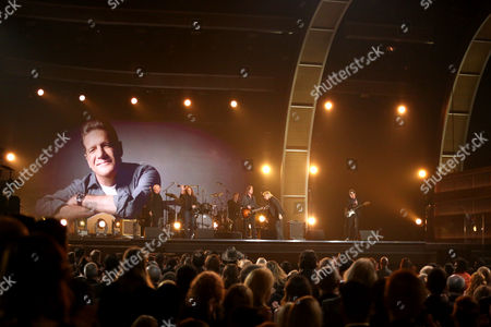 Stock Image of Bernie Leadon, from left, Don Henley, Timothy B. Schmit, Jackson Browne, Joe Walsh, and Steuart Smith perform a tribute to Glenn Frey at the 58th annual Grammy Awards, in Los Angeles