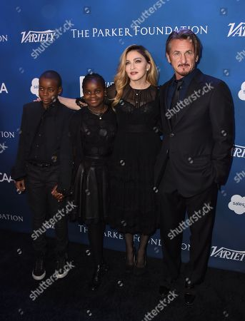 From left, David Banda, Mercy James, Madonna and Sean Penn arrives at the 5th Annual Sean Penn & Friends HELP HAITI HOME Gala Benefiting at the Montage Hotel on in Beverly Hills, Calif