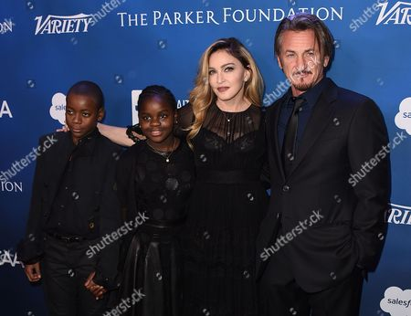 From left, David Banda, Mercy James, Madonna and Sean Penn arrive at the 5th Annual Sean Penn & Friends HELP HAITI HOME Gala Benefiting at the Montage Hotel on in Beverly Hills, Calif