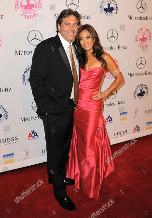 Stock Picture of Jesse Sloan and Carrie Ann Inaba arrive at The Carousel of Hope at The Beverly Hilton Hotel, in Beverly Hills