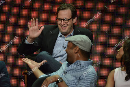 """Executive Producer Andrew Kreisberg and Jesse L. Martin gesture on stage during """"The Flash"""" panel at the The CW 2014 Summer TCA held at the Beverly Hilton Hotel, in Beverly Hills, Calif"""