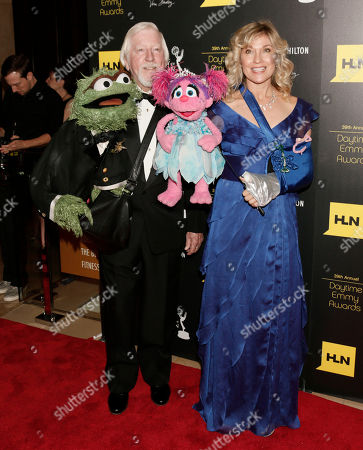 From left, puppet Oscar the Grouch, Caroll Spinney, puppet Abby Cadabby and Leslie Carrara Rudolph arrive at the 39th Annual Daytime Emmy Awards on HLN at the Beverly Hilton Hotel on in Beverly Hills, Calif