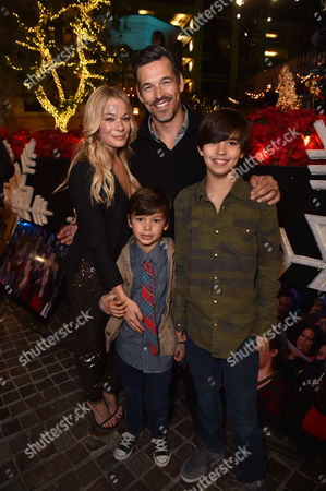 Stock Picture of LeAnn Rimes, and from left, Eddie Cibrian, Jake Cibrian, and Mason Cibrian attend The Grove's 12th Annual Christmas Tree Lighting Spectacular Presented By Citi at The Grove on in Los Angeles, California