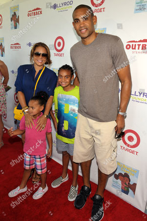 Tamia Hill, left, Grant Hill, right, and their children attend The HollyRod Foundation's 3rd Annual My Brother Charlie Family Fun Festival at Culver Studios, in Culver City, Calif