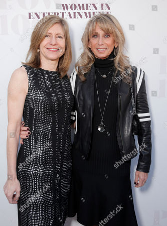 Frances Berwick, left, and Bonnie Hammer arrive at a celebration of The Hollywood Reporter's Power 100 Women in Entertainment breakfast at Milk Studios, in Los Angeles
