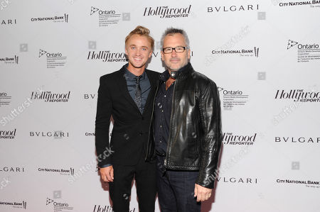 Tom Felton, left, and Charlie Stratton arrive at The Hollywood Reporter's 2013 TIFF Cocktail Reception presented by Bulgari on in Toronto