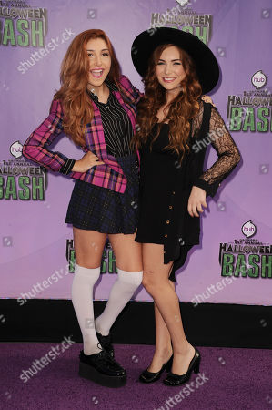 """Jennessa Rose, left, and Julianna Rose arrive at """"Hub Network's First Annual Halloween Bash"""", at the Barker Hanger in Santa Monica, Calif. The star-studded special will be broadcasted on the Hub Network on Saturday Oct. 26, 2013"""