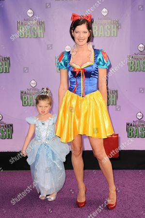 "Natalia Scout Lee Stafford, left, and Michelle Stafford arrive at ""Hub Network's First Annual Halloween Bash"", at the Barker Hanger in Santa Monica, Calif. The star-studded special will be broadcasted on the Hub Network on Saturday Oct. 26, 2013"
