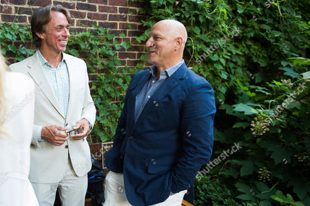 Stock Image of John Besh, left, and Tom Colicchio attend the kick-off event for the James Beard Foundation's Taste America 10-city national tour, held at the James Beard House in New York City