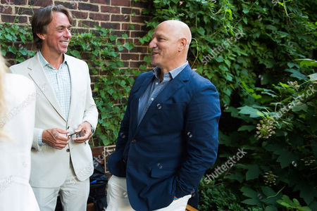 Stock Photo of John Besh, left, and Tom Colicchio attend the kick-off event for the James Beard Foundation's Taste America�'s 10-city national tour, held at the James Beard House in New York City