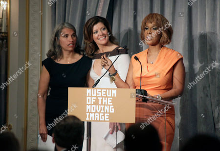 Stock Photo of From left, producer Yvette Vega and television journalists Norah O'Donnell and Gayle King speak at the Museum of the Moving Image Annual Honors Benefit, in New York
