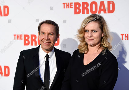 Artist Jeff Koons and his wife Justine Wheeler Koons pose together at The Broad museum's opening and inaugural dinner, in Los Angeles