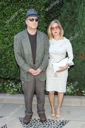 Actor Albert Brooks and wife Kimberly Shlain arrive at the The Rape Foundation Annual Brunch at Greenacres on in Beverly Hills, Calif