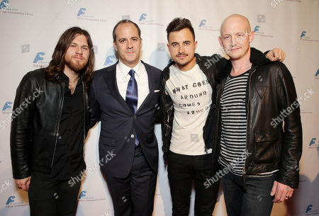 Second from left, Showtime's David Nevins with Dave Welsh, Joe King and Isaac Slade, of the musical group The Fray, at The Saban Community Clinic 37th Annual Dinner Gala, on in Beverly Hills, Calif