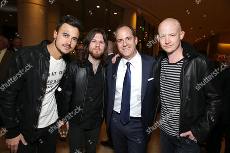 Second from right, Showtime's David Nevins with Joe King, Dave Welsh and Isaac Slade, of the musical group The Fray, at The Saban Community Clinic 37th Annual Dinner Gala, on in Beverly Hills, Calif