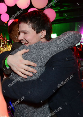 Cameron Monaghan, left, and Danila Kozlovsky greet each other at a Vampire Academy special event featuring a performance by Iggy Azalea hosted by The Weinstein Company and Universal Music Enterprises,, in Los Angeles