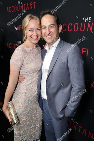 """Stock Image of Producer Lynette Howell Taylor and Greg Silverman, President of Creative Development and Worldwide Production for Warner Bros. Pictures, seen at the Los Angeles World Premiere of Warner Bros. Pictures' """"The Accountant"""" to benefit the American Film Institute at the TCL Chinese Theater, in Los Angeles"""