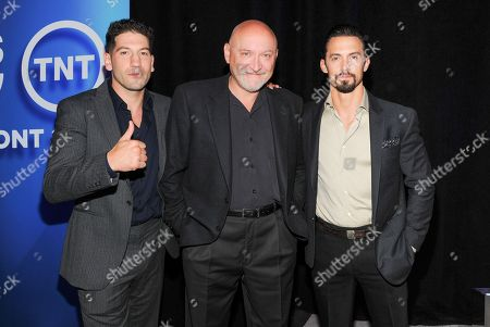 Director and writer Frank Darabont, center, poses with actors Jon Bernthal, left, and Milo Ventimiglia at the TNT and TBS 2013 Upfront at the Hammerstein Ballroom on in New York