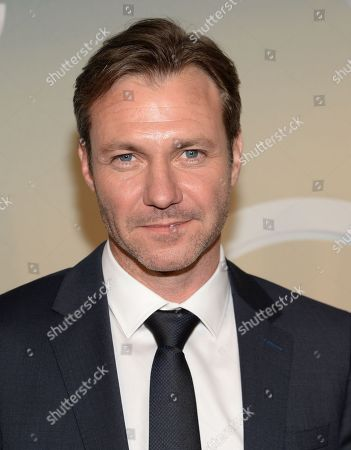 Chris Vance poses backstage at the TNT and TBS Network 2014 Upfront Presentations at Madison Square Garden, in New York
