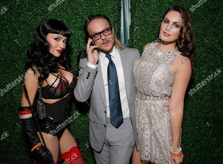 Stock Image of Randall Slavin (center) attends Treats! Magazine's 3rd Annual Trick or Treats! Halloween Party presented by Jose Cuervo on in Los Angeles