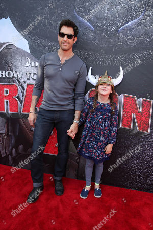 Stock Image of Dylan McDermott and Charlotte Rose McDermott seen at the Twentieth Century Fox and DreamWorks Animation Los Angeles Premiere of 'How to Train Your Dragon 2', in Westwood, Calif