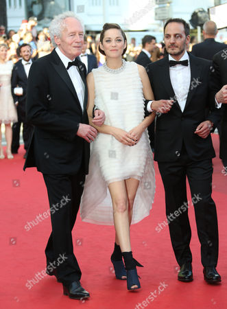 From right, Fabrizio Rongione, Marion Cotillard and Jean-Pierre Dardenne on the red carpet for the screening of Two Days, One Night (Deux jours, une nuit) at the 67th international film festival, Cannes, southern France