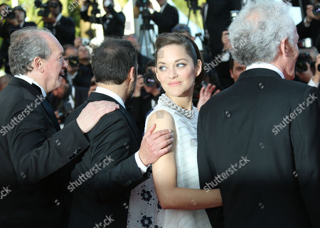 From left, Luc Dardenne, Fabrizio Rongione, Marion Cotillard and Jean-Pierre Dardenne on the red carpet for the screening of Two Days, One Night (Deux jours, une nuit) at the 67th international film festival, Cannes, southern France