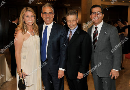 John Rogovin, second from left, and his wife Jaye, left pose with Barry Meyer, second from right, Chairman of Warner Bros. Entertainment and Bruce Rosenblum at the United Friends of the Children Brass Ring Awards Dinner at the Beverly Hilton Hotel on in Beverly Hills, Calif