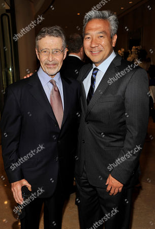 Barry Meyer, left, Chairman of Warner Bros. Entertainment, poses with Kevin Tsujihara, Chief Executive Officer of Warner Bros., at the United Friends of the Children Brass Ring Awards Dinner at the Beverly Hilton Hotel on in Beverly Hills, Calif