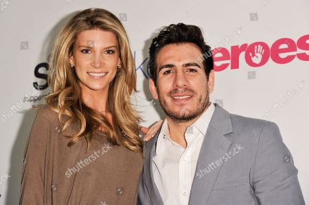 Clark Gilmer, left, and Kenny Florian arrive at the Unlikely Heroes Red Carpet Spring Benefit, in Los Angeles
