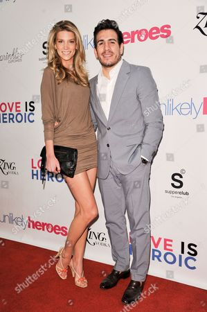 Stock Photo of Clark Gilmer, left, and Kenny Florian arrive at the Unlikely Heroes Red Carpet Spring Benefit, in Los Angeles